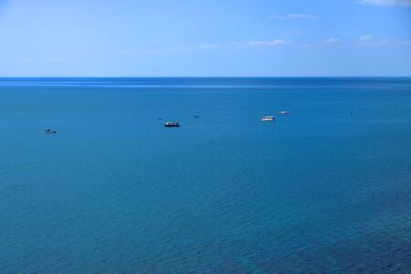 Boats in sea on sunny day Stock Photo