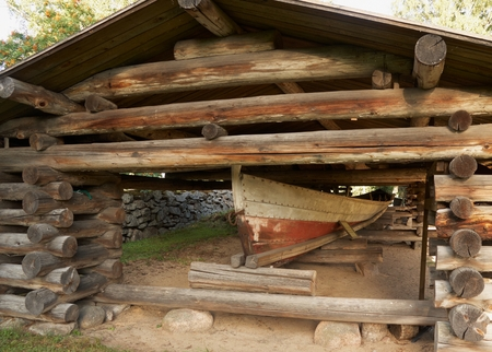 Ancient wooden boat in shed in Petajavesi near old church, Finland