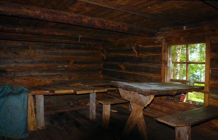 Room in wooden old hut Foto de archivo