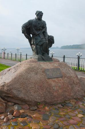 Burlak monument on Rybinsk embankment on rainy summer day, Yaroslavl region, Russia
