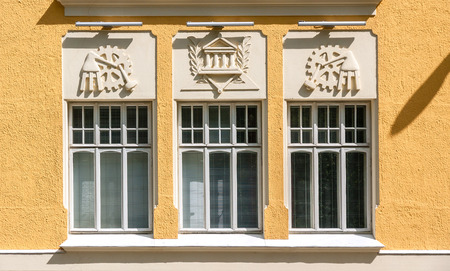 Bas-reliefs on the facade of the yellow house, Kuopio, Northern Savonia, Finland