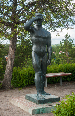 Mikkeli, Finland, June 16, 2015: Sculpture of a naked man: Looking at the tower