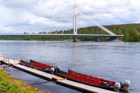 Yatkiank?ntill bridge across the river Kemijoki and pleasure boat, Rovaniemi, Finland