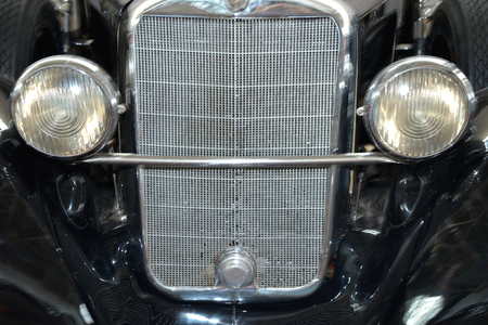 Front bumper and headlights of vintage car Standard-Bild - 125201847
