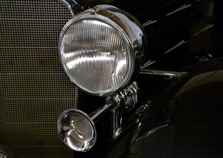 Front bumper and headlights of vintage car
