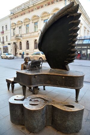 Lodz, Poland, December 12, 2018: Monument pianist Arthur Rubinstein, Piotrkowska Street