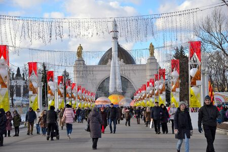 Moscow, Russia, March 09, 2019: Exhibition of Achievements of National Economy (VDNKh). Festive festivities of people on Space Pavilion with Vostok (rocket). Фото со стока - 128667693