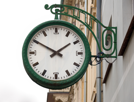 Street clock on the wall, Jelenia Gora, Poland