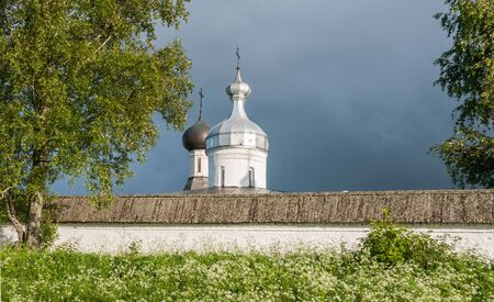 Wall and domes Cathedral of Nativity of Blessed Virgin Mary and Church of St. Martinian of Ferapontov monastery in summer, Ferapontovo villadge, Vologda region, Russia Stock Photo