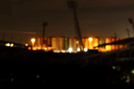 Blur of the city at night. Bokeh of light from electric lamp in the city at night.