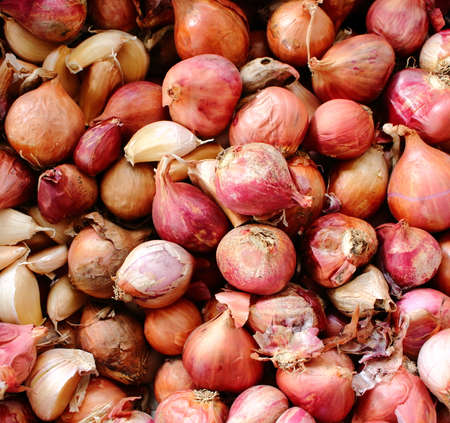 Abstract background of red shallots in the basket. Shallots is Thai herb. Top view of red shallots. Stock Photo