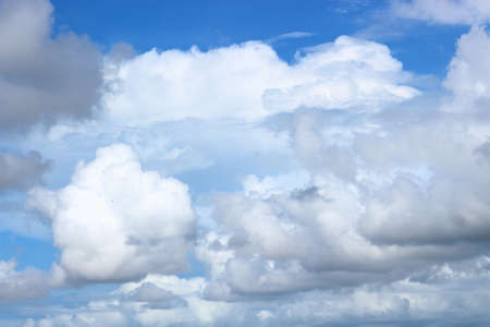 Abstract background of white clouds in blue sky.
