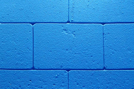 Abstract background of blue brick wall in the room with seam pattern.