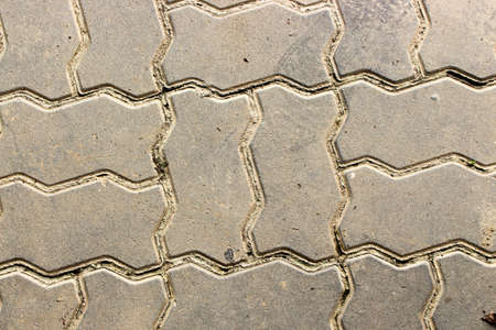 Abstract background of old brick for footpath with seamless pattern. Texture of concrete block pavement.