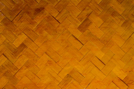 Abstract background of old bamboo basket wall in the house. Wooden background. Pattern from thin bamboo stripes.