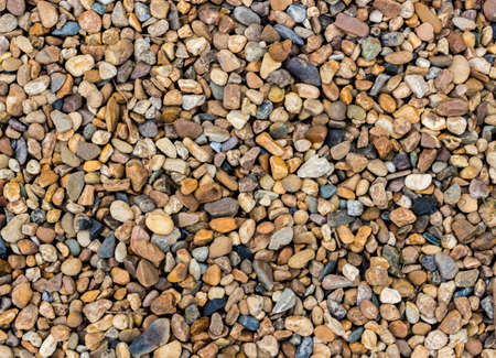 Abstract background and texture of colorful pebble in the landscape gardening. Colorful gravel pattern.