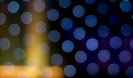 Abstract background of colorful bokeh at night.