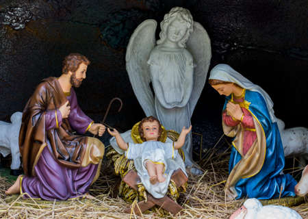 Close up of man statue and woman statue and baby statue and white angel statue in the cave for christmas day. Stock Photo
