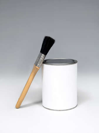 bristles: paintbrush with black bristles near the tin