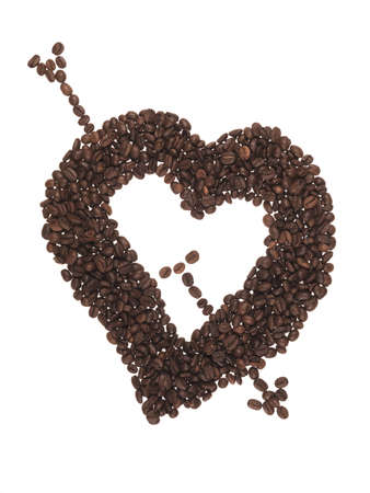 form of heart made of coffee beans on teh white background photo