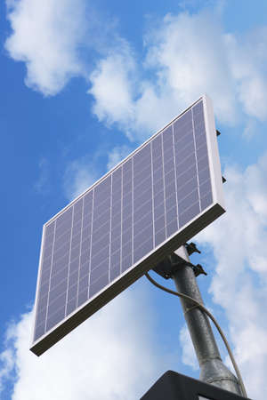 source of iron: little solar panel between clouds in  the sky Stock Photo