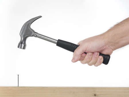 hand of man that hold hammer on the white background while pounding Stock Photo