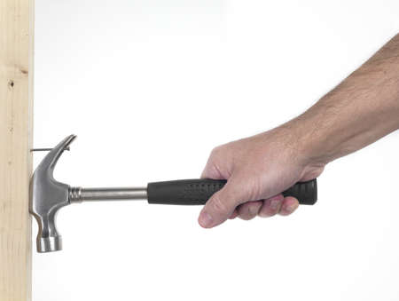 hand of man that hold hammer on the white background during a  extration of nail Stock Photo - 8347067