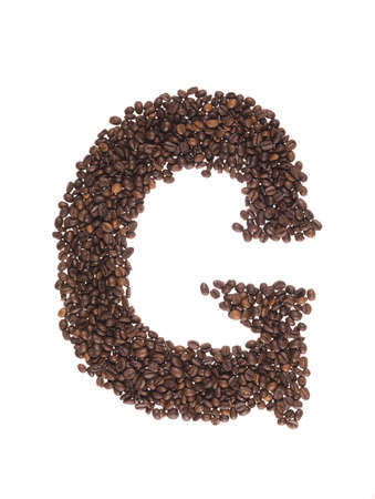 letters of alphabet  made of coffee beans on a white background photo