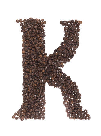 letter of alphabetic made of coffee beans on a white background photo