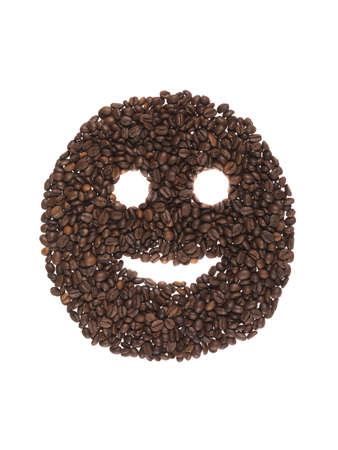 smile face made of coffee beans on a white background photo