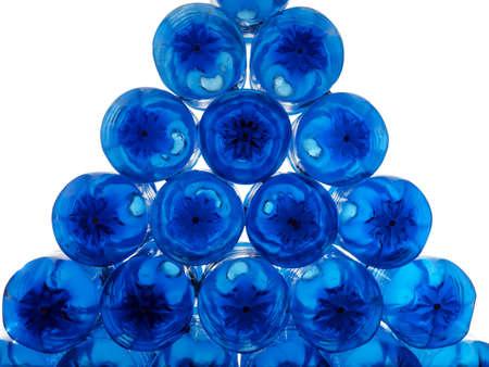 pile of blue plastic bottles on white background photo
