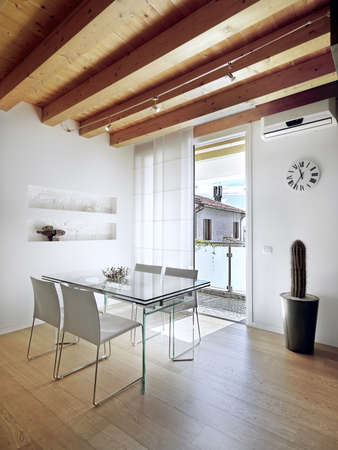 modern dining table in the attic