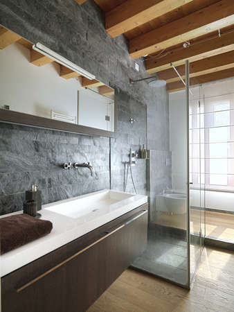 modern bathroom with shower cubicle in the center