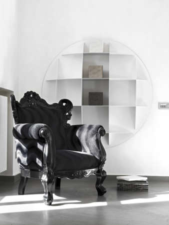 black armchair near white bookcase