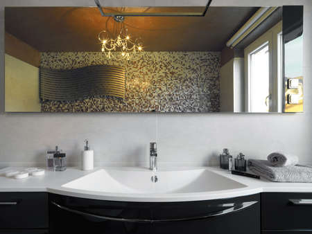 bathroom mirror: washbasin in hte modern bathroom Stock Photo