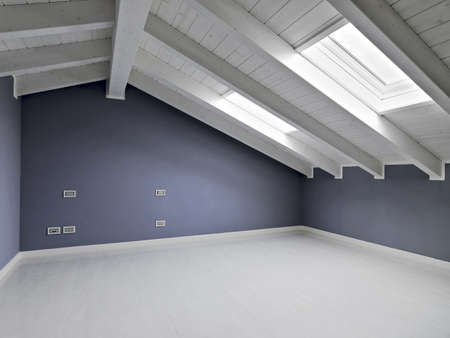 mansard: empty room in the attic with wood ceiling Stock Photo