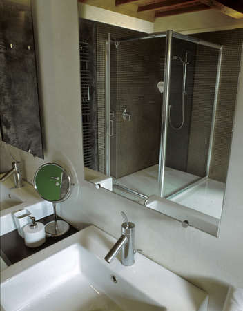 shower cubicle: detail of washbasin and shower cubicle  in a modern bathroom