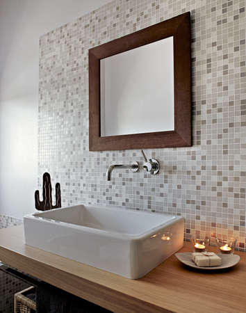 detail of white ceramic washbasin in a modern bathroom