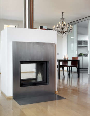 modern fireplace with dining table photo