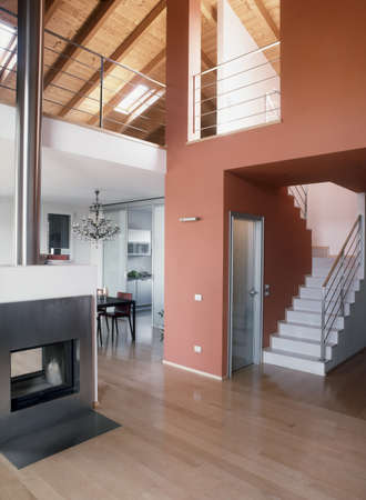modern fireplace with staircase