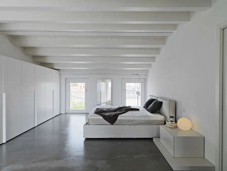 modern bedroom in the attic room