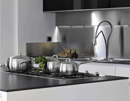 steel pans on the burner in a modern kitchen Stock Photo - 14420924