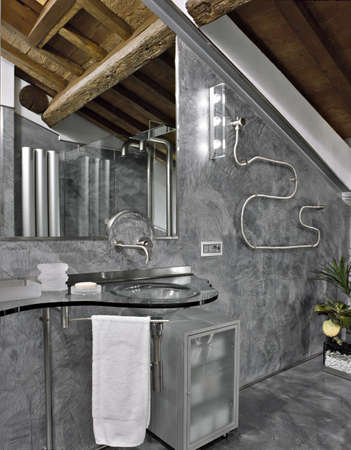 mansard: detail of washbasin in the modern bathroom in the attic room Stock Photo