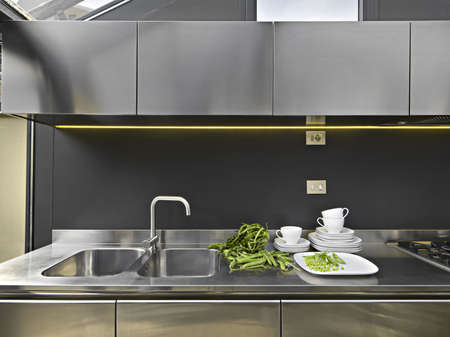 vegetables and dishes on the steel worktop in a modern kitchen Stock Photo - 14420950