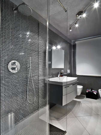 modern bathroom with glass shower cubicule photo