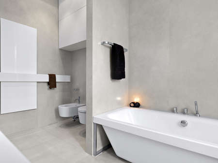 interior desing: modern bathtub in a modern bathroom with  overlooking on sanitaryware and, marble floor