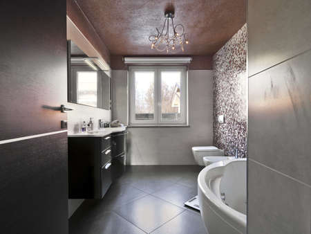 mosaic floor: modern bathroom with bathtub and washbasin