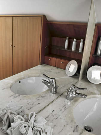 interior desing: detail of tap in a modern bathroom