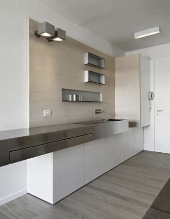 modern kitchen in entrance with wood floor Stock Photo