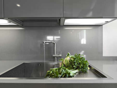 interior desing: vegetables near to sink in a modern kitchen Stock Photo